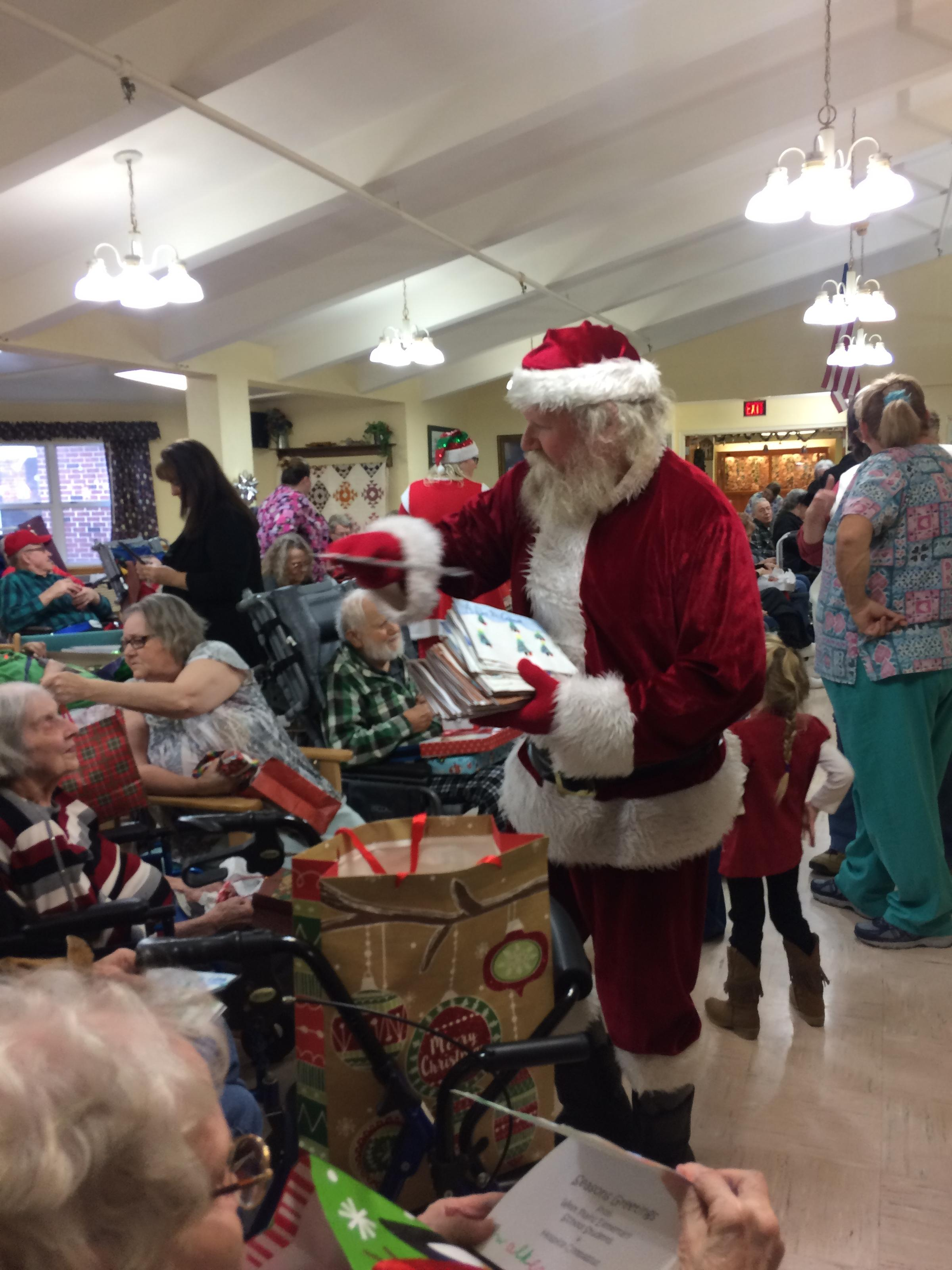 each december residents receive a gift from santa claus at the annual kabul nursing home holiday party