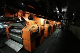 Newspapers roll off the presses.