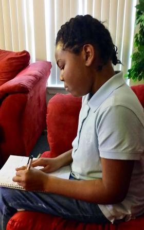 Fifth grader Simya Gantt is doing better in school thanks to a unique program in Tacoma, Wash.