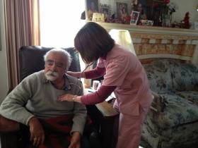 Sutter Health nurse Aileen Capuyan listens to Bob Martinez's lungs.