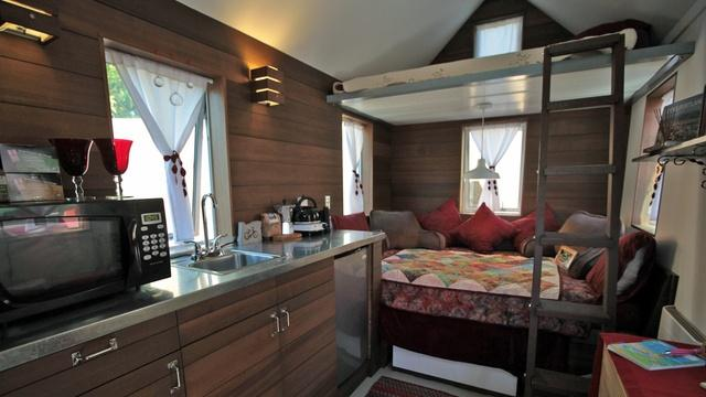 The Pearl is the smallest of Caravan's three tiny houses at 90 square feet on the main floor. It is also the most modern with sleek countertops and dark wood finish. Each unit has unique features.