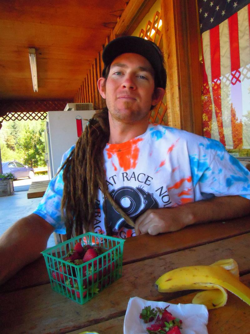 """Brian Thibeault considers himself a """"hippy"""" and was grateful when Craig and Amber Hamm boosted the store's natural food offerings. """"This store has anything you need,"""" he says snacking on a basket of organic strawberries."""