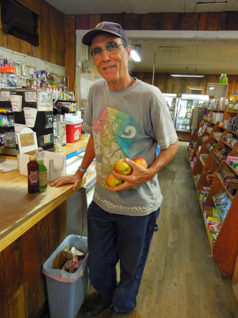 "A Williams local named ""IWILL"" picks up some Kombucha and Gravestein apples to satisfy his raw food diet. ""This place is the best,"" he says, ""I come here everyday."""