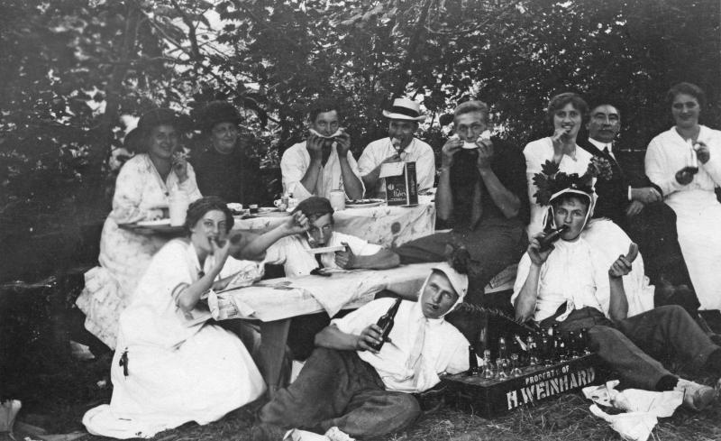 Picnickers enjoying food and drink, including Weinhard beer. The Weinhard brand was among several regional Pacific Northwest beers which were staples in the Northwest market during the decades following the repeal of Prohibition.