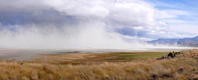 Clouds of dust swirl above Summer Lake, a large, shallow alkali lake in south-central Oregon.  View is to the southeast from a hill near the base of Winter Ridge, visible on the right.
