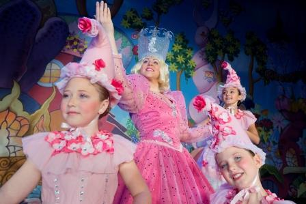 Glinda the Good Witch (Kim Acuña) cavorting with merry Munchkins.