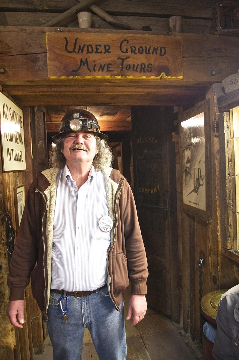 A tour guide at the Ponderosa Saloon and Mine in Virginia City, a quick day trip from Reno. Visitors wear hardhats to explore the tunnels, antique mining equipment, crosscuts, winzes, and shafts of this once prosperous gold mine.