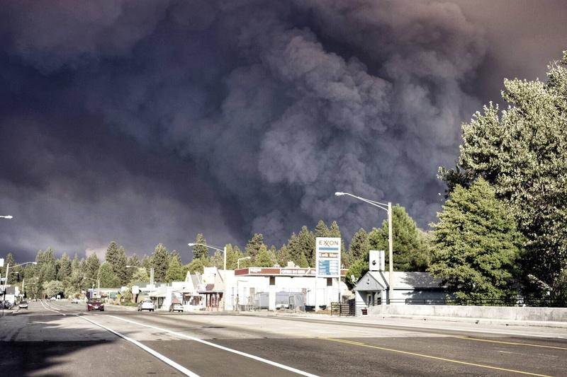 The town of Burney on Saturday, with a backdrop of smoke from the Eiler Fire.