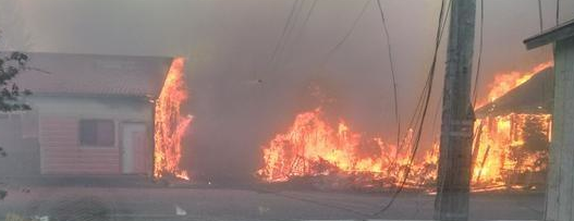 A home burns in the Boles Fire