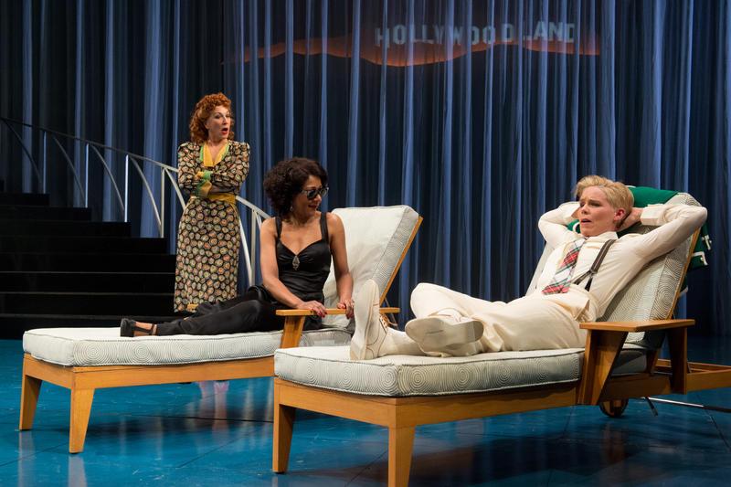 "Maria (Kate Mulligan) and Olivia (Gina Daniels) listen as Viola (Sara Bruner), disguised as ""Cesario,"" attempts to woo on Orsino's behalf."