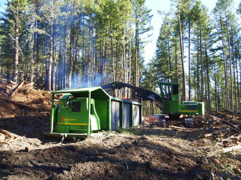 The Air Curtain Burner Firebox In Use To Reduce Forest Fuels While  Minimizing Smoke Impact.