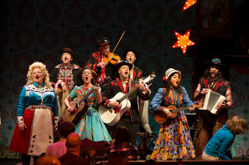 The Yeomen of the Guard ensemble sings one of Gilbert and Sullivan's songs, rearranged country-western style.