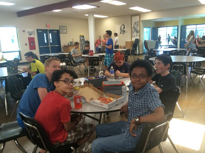 Ashland Middle School student Joshua Canete-Wilson (R, front) and some of his friends in the school cafeteria at lunchtime.