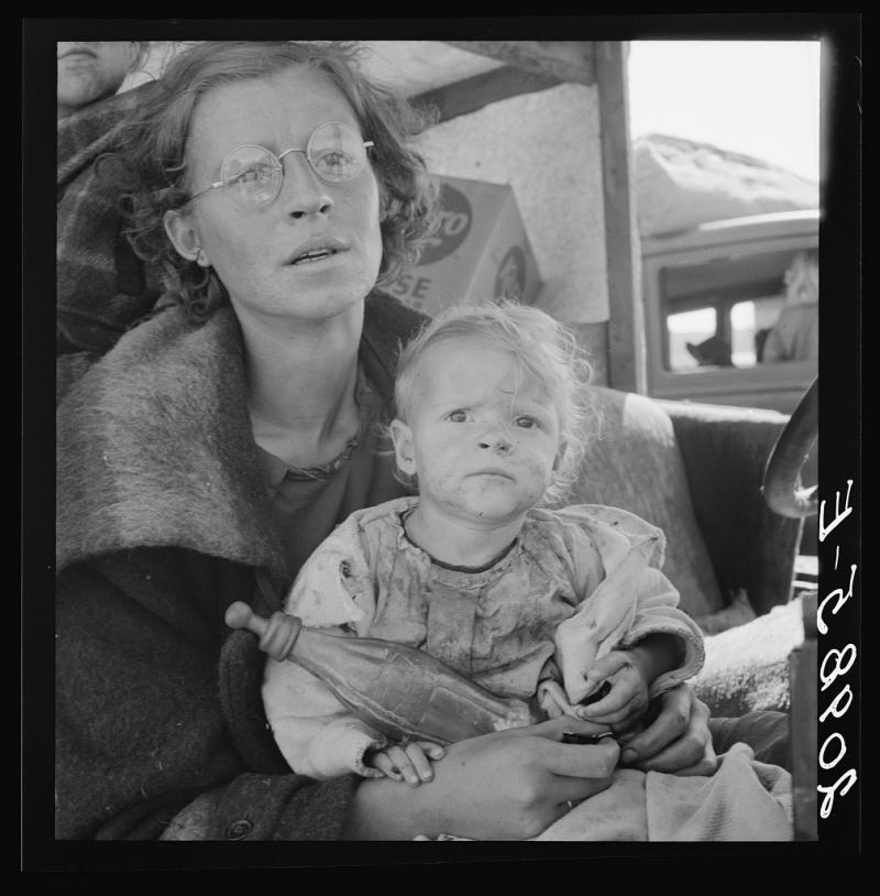 Mother and two children on the road. Tulelake, Siskiyou County, California. September 1939.