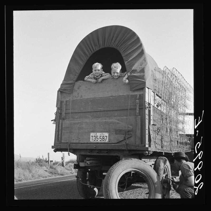 Just arrived from Kansas. On highway going to potato harvest. 1939 Sept. Near Merrill, Klamath County, Oregon