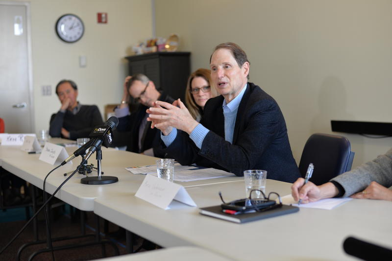 Oregon Senator Ron Wyden speaks with health care professionals at a roundtable discussion on the impacts of possible cuts to Medicaid programs. The meeting was held at La Clinica, near Medford on Thursday, Feb. 23.