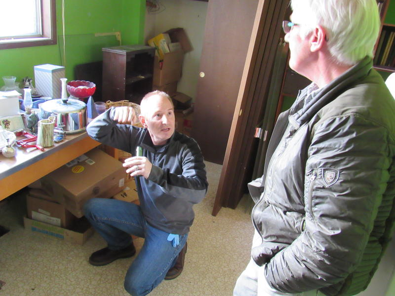 Energy Auditor Dan Cunningham explains to homeowner Carolyn Brown an air leak he's found near a heating duct in the fixer-upper home she's remodeling.
