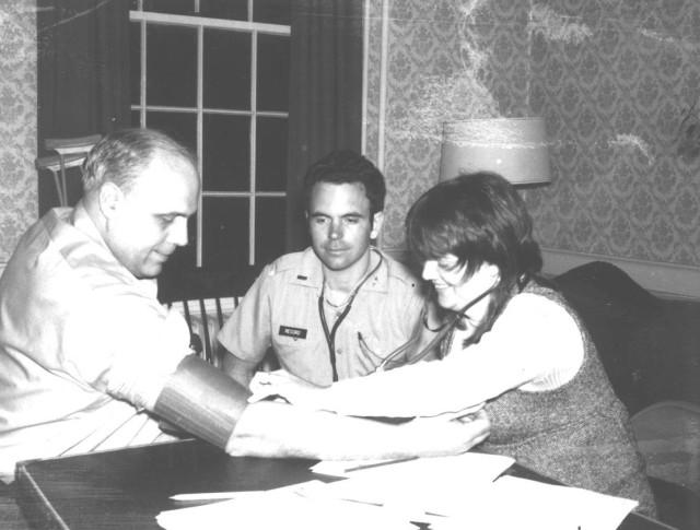Dr. Burgess Record, center, works with a nurse in 1974 to check a patient's blood pressure. At the time, blood pressure checks were a rare occurrence in rural Maine. Record and his peers helped to reshape the health culture in Franklin County, Maine.