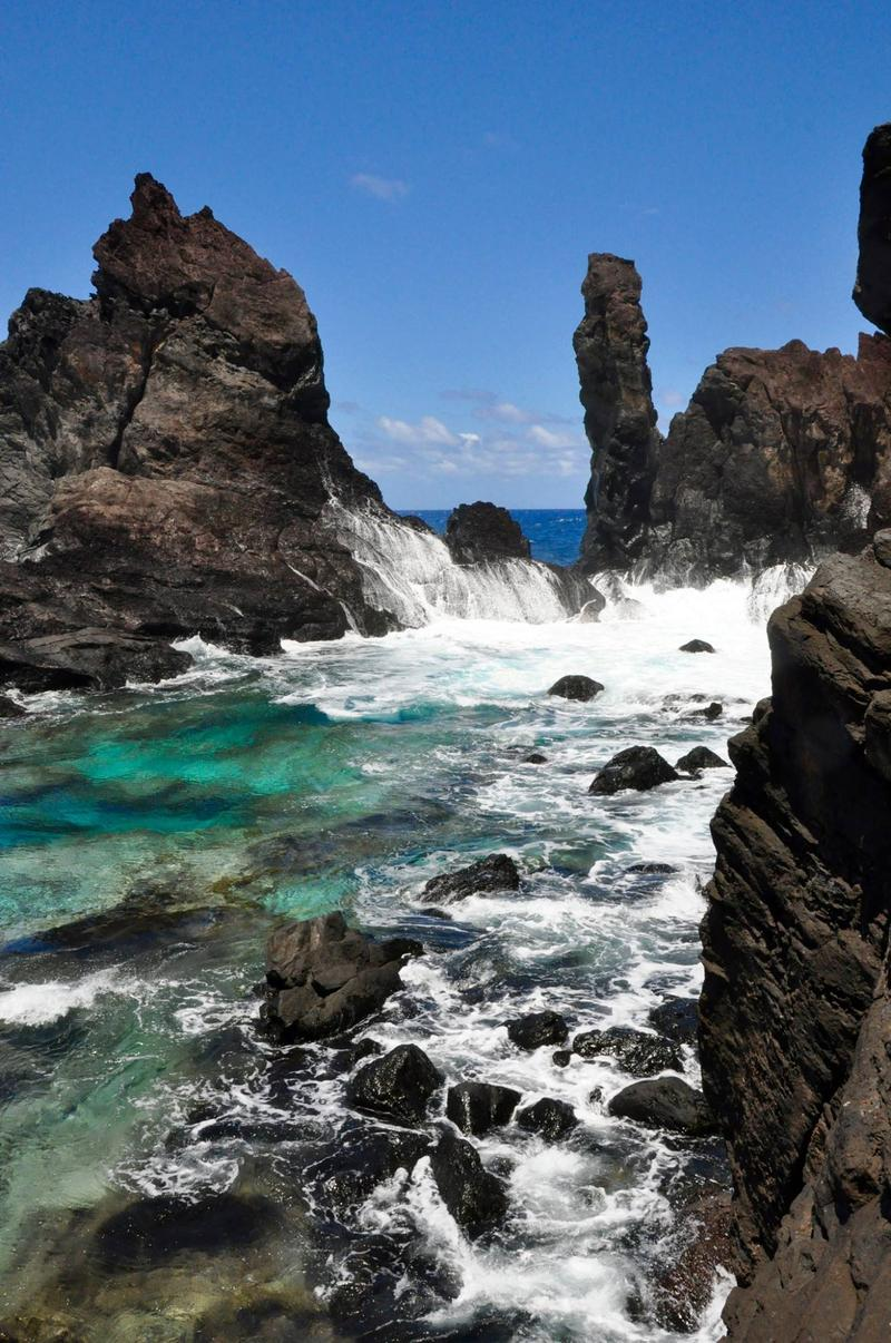 The surf crashes on Pitcairn Island's St. Paul Rocks.