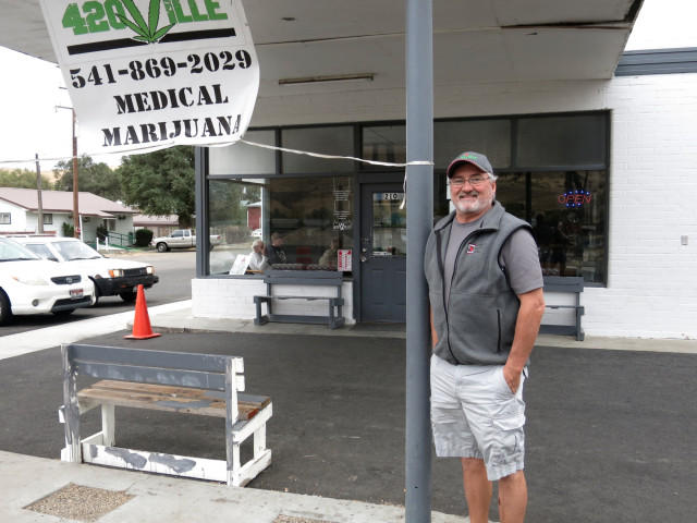 Scott Matthews of the 420Ville dispensary in Huntington, Oregon, hopes a drop of marijuana under his tongue every day will prevent cancer.