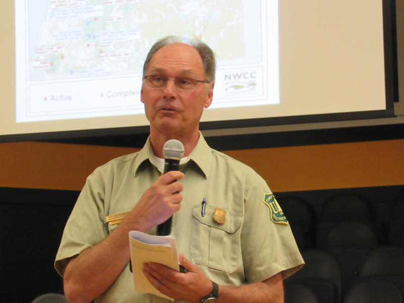 Rogue River - Siskiyou National Forest Supervisor Rob McWhorter was among the officials who spoke to a largely hostile crowd Thursday night to explain how they had managed the Chetco Bar fire, and why.
