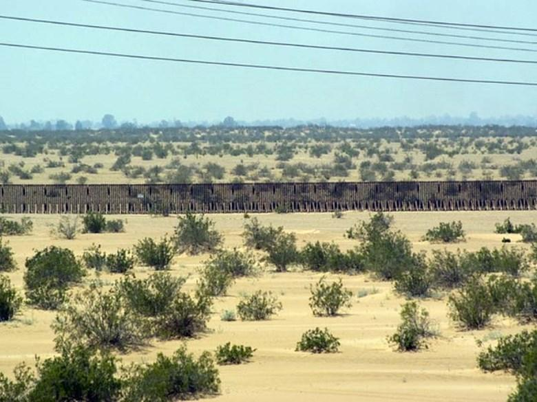 The border fence is seen in the desert along the California border.