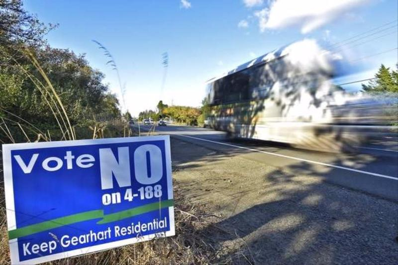 "A ""Vote No on Measure 4-188"" sign is seen on the edge of U.S. Highway 101 in Gearhart, Oregon."