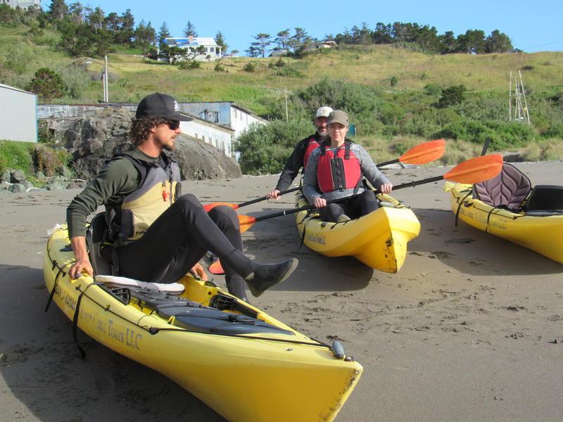 Sea kayak guide Anthony Sigg, with South Coast Tours, prepares Sarah Carter and Brad Davis of Atlanta, GA for a paddling tour off Port Orford.