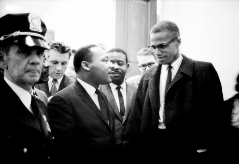 Martin Luther King and Malcolm X await a press conference in 1964.