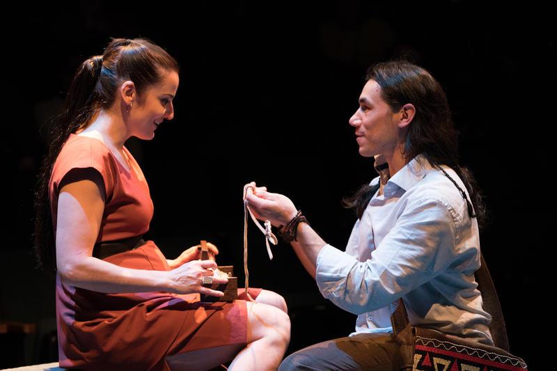 Se-ket-tu-may-qua (Steven Flores) gives Le-le-wa'-you (Tanis Parenteau) a wampum necklace that belonged to his mother.
