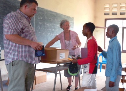 Bryce Smedley (L) works with teachers in Africa.