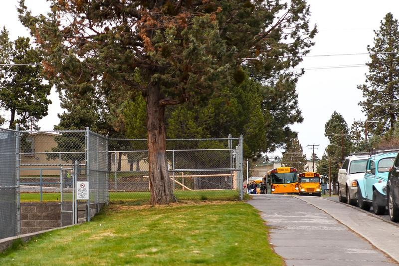 School buses arrive at Bend Senior High School at 7:15 a.m. on April 18, 2018.