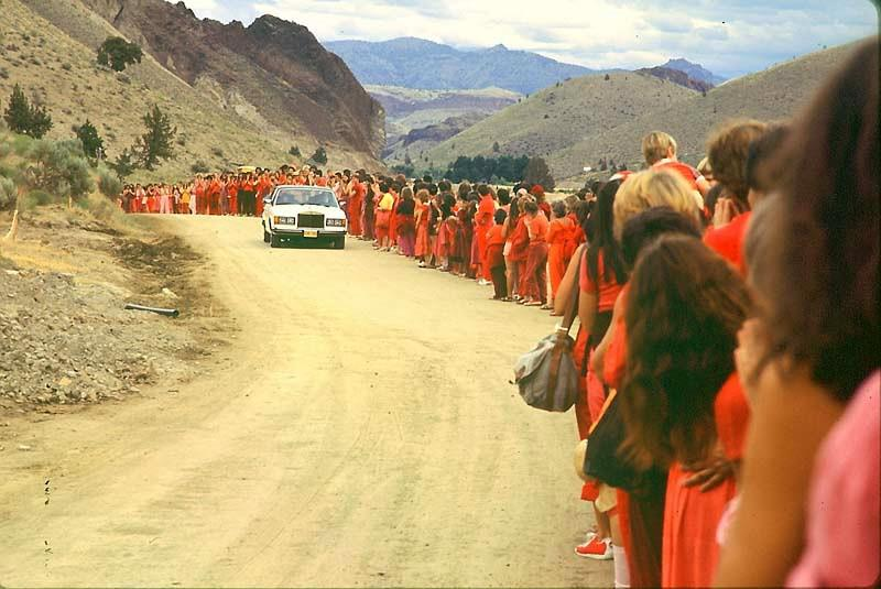 Rajneesh drives by the flock at the ranch, 1982.