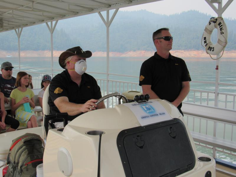 Matthew Doyle, general manager at Lake Shasta Caverns, and Tim Lehman, captain of the Cavern Princess tour boat, ride across Lake Shasta with a group of tourists to visit the caverns on Aug. 17.