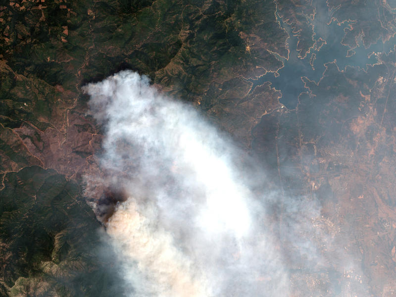 A satellite image provided by DigitalGlobe shows the Carr wildfire in Redding.