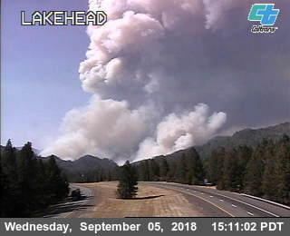 The CalTrans road cam at the Lakehead overcrossing shows a plume of smoke rising from the new Delta fire in Shasta County, California.