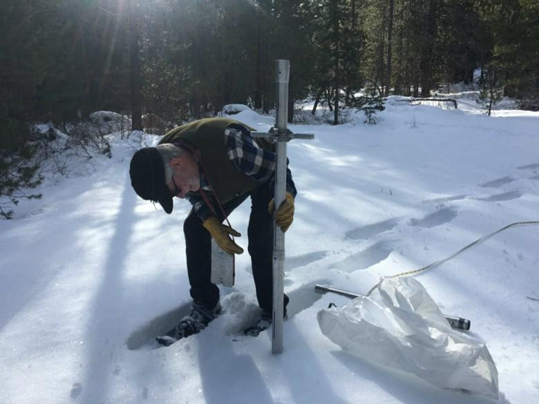 Frank Gehrke conducts a snow survey in the Sierra in March 2018.