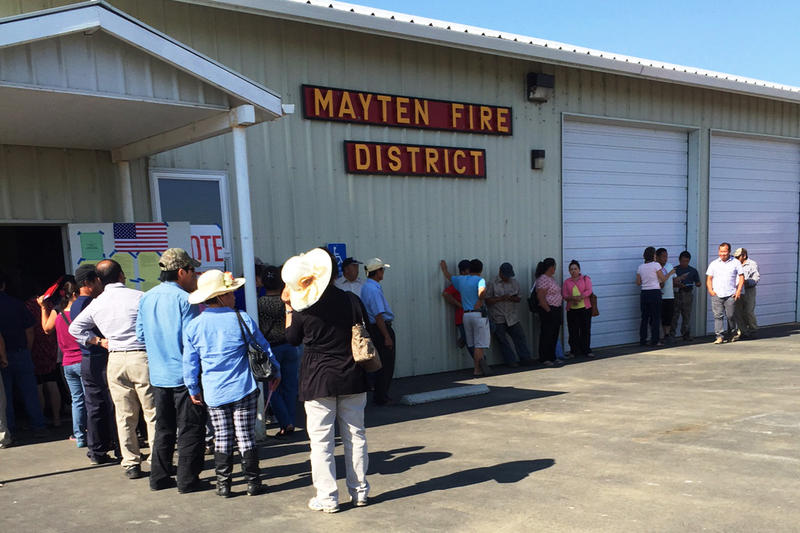Hmong voters lined up outside the Mayten Fire District building in Montague, California.