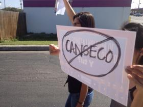 Protestors holding signs in English and Spanish stand outside the Canseco campaign headquarters the Friday before election day. Races between two Hispanic candidates went overwhelmingly toward the democratic candidate in Texas.