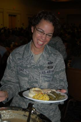Sgt. Tasha Diaz fills her plate up for a Thanksgiving celebration at JBSA-Lackland.