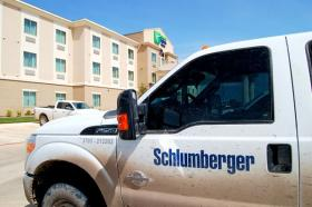 A Schlumberger work truck parked in front of a new Holiday Inn in Cotulla where many oilfield workers are taking up temporary residences.