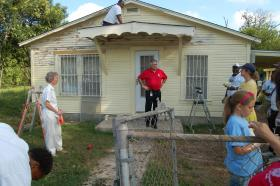 District 6 Councilman Ray Lopez speaks to volunteers during a work day for Rebuilding Together San Antonio.