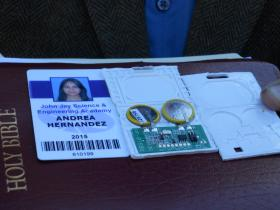The ID on the left was issued to Hernandez during her Freshman year; it's this card she wants to use for school purposes. The microchip in the middle is the actual RFID tag. The casing of the RFID tag was broken open for demonstration.