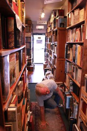 Books are stacked everywhere at Cheever Books and you sometimes have to twist and turn to get a better view.