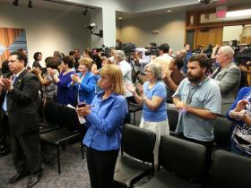 Supporters applaud Chan at a news conference where she defended her homophobic remarks that were recorded and later released to the Express-News.