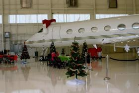 Santa waits inside his plane for the arrival of 75 critically-ill children coming to see him at the North Pole Dec. 7.