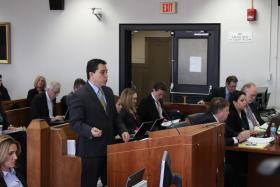 MALDEF attorney David Hinojosa at the podium.