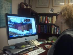 Dr. Ruth Berggren views photo of Haitian children she treated after the 2010 earthquake.