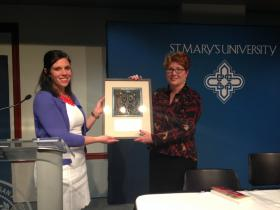 Author Karin Richmond receives the Art of Peace Award at St. Mary's University