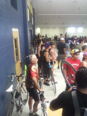 Cyclists arrive at Merrill Elementary for final public meeting on S. Flores lane changes.